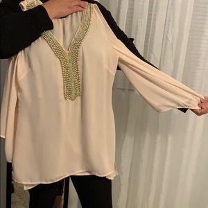 Light creamy peach blouse